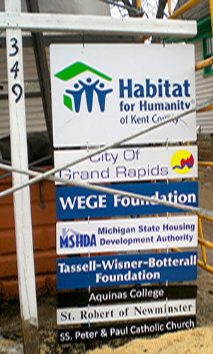 This sign tells the story of the good organizations behind the Habitat LEED restoration of this house in the Wealthy Street neighborhood near Wealthy Theatre.