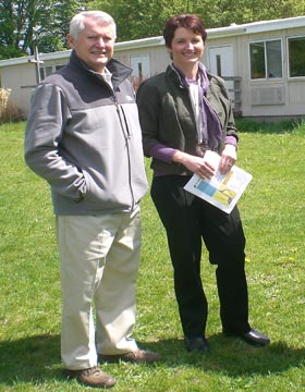 Blandford Nature Center's director Annoesjka Steinman and Dr. Bill Laidlaw, grandfather of a BEEP, are pictured in front of the portable classroom that will be replaced by the new school.