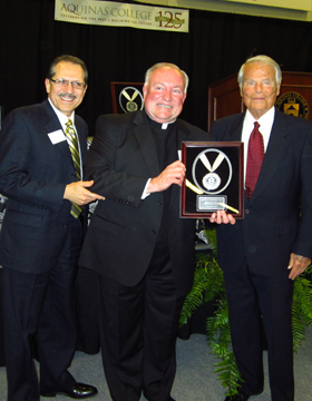 President Oliverez is shown here with Father Duncan (above) as they present the Reflection Award to Ralph Hauenstein. A successful international businessman, Colonel Hauenstein was also a WW II hero as a top intelligence officer under General Dwight Eisenhower. Ralph Hauenstein will celebrate his 100th birthday this year.