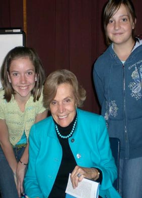 Dr. Sylvia Earle signs autographs for City High Middle School students Sherri Trumbell and Jenifer White.
